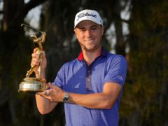 Justin Thomas holds the trophy after winning The Players Championship (John Raoux/AP)