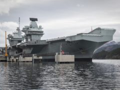 HMS Queen Elizabeth carrier strike group to the region on its maiden operational mission later this year (Jane Barlow/PA)