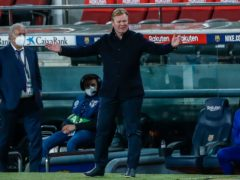 Ronald Koeman's Barcelona are now four points from the league summit (Joan Monfort/AP)