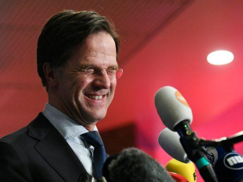Dutch caretaker prime minister Mark Rutte speaks with the media (Piroschka van de Wouw/AP)