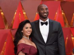 Vanessa and Kobe Bryant at an awards ceremony. The former basketball star's widow has posted the names of four police officers she alleges took and shared graphic photos from the site of the helicopter crash that killed her husband, their daughter, Gianna, and seven others (Richard Shotwell/Invision/AP)