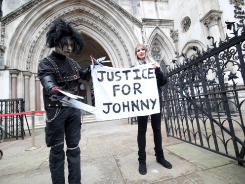 Supporters of Johnny Depp, one dressed as Edward Scissorhands, outside the Royal Courts of Justice (Yui Mok/PA)