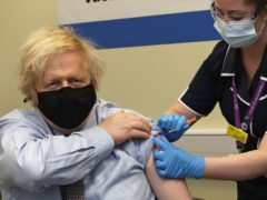 The UK is on the verge of reaching the major milestone of giving more than 50% of the adult population their first dose of coronavirus vaccine (Frank Augstein/PA)
