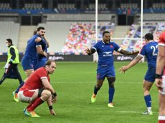 France's Virimi Vakatawa (centre) celebrates as Wales' Alun Wyn Jones (left) sits dejected after the Guinness Six Nations match at Stade de France (David Niviere/PA)