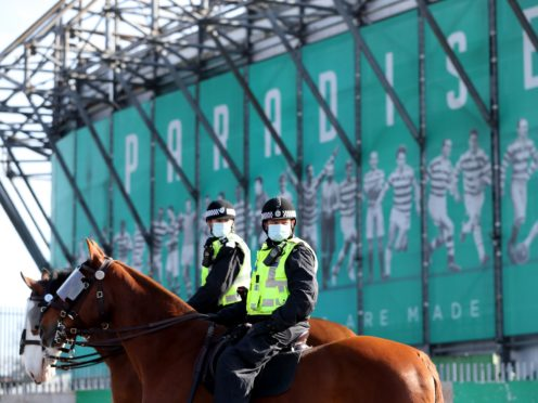 Police gather outside Celtic Park (Jane Barlow/PA)