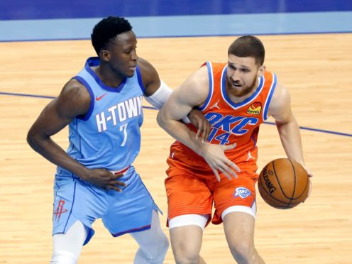 Houston Rockets guard Victor Oladipo tangles up with Oklahoma City Thunder guard Svi Mykhailiuk (Michael Wyke/AP)