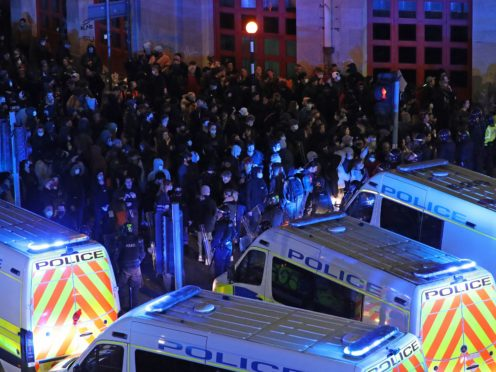 Riot police move down Rupert Street in Bristol towards protesters (Andrew Matthews/PA)