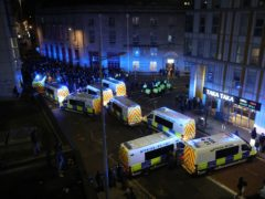 Riot police, with police horses and police vehicles, move down Rupert Street in Bristol towards protesters (Andrew Matthews/PA)