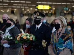 Representatives of victims and others mark the anniversary of the attack at the airport in Brussels (Stephanie Lecocq, via AP)