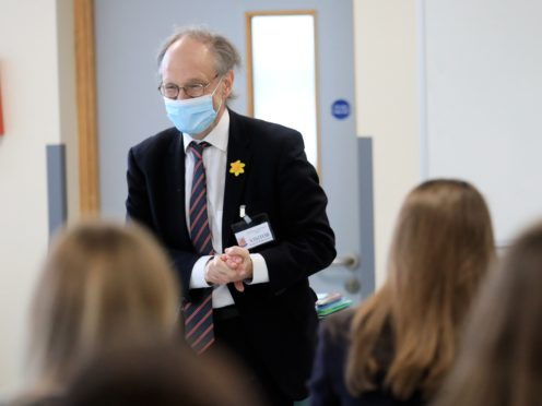 Education Minister Peter Weir speaks to pupils during a visit to Wallace High School in Lisburn (Peter Morrison/PA)