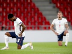 England's Raheem Sterling (left) and Kalvin Phillips taking a knee (Nick Potts/PA)