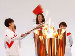 """The torch is lit by a member of Japan's women's national soccer team """"Nadeshiko Japan"""" during the Tokyo 2020 Olympic Torch Relay Grand Start in Naraha, Fukushima prefecture, northeastern Japan, Thursday, March 25, 2021. The torch relay for the postponed Tokyo Olympics began its 121-day journey across Japan on Thursday and is headed toward the opening ceremony in Tokyo on July 23. (Kim Kyung-Hoon/Pool Photo via AP)"""