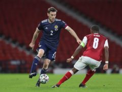 Full-back Stephen O'Donnell, left, believes Scotland are still heading in the right direction as they seek the first win of their World Cup qualifying campaign (Jane Barlow/PA)