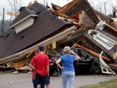 At least five people are dead after a series of tornadoes hatched by early spring 'super cell' storms tore across Alabama and moved into Georgia early on Friday (Butch Dill)
