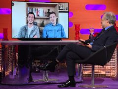 Micheal Richardson (left) and his father, Liam Neeson, are interviewed remotely by host Graham Norton for his BBC chat show (Matt Crossick/PA Wire)
