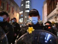 A daffodil on a police officer's shield placed there by a protester during the 'Kill The Bill' protest in Bristol (Ben Birchall/PA)