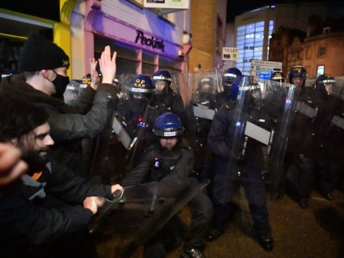 Police officers move in on demonstrators in Bristol during the 'Kill The Bill' protest against The Police, Crime, Sentencing and Courts Bill. Picture date: Friday March 26, 2021.