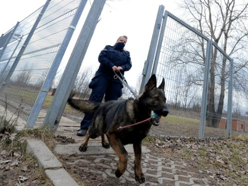 Police officer Katarzyna Matuszewska after training with a patrol dog (AP)