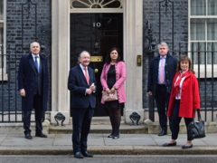 From left, Sir Iain Duncan Smith, David Alton, Nus Ghani, Tim Loughton and Helena Kennedy, Baroness Kennedy of The Shaws outside Downing Street (Ian West/PA)