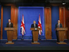 (left to right) England's chief medical officer Professor Chris Whitty, Prime Minister Boris Johnson and England's chief scientific adviser Sir Patrick Vallance in the new briefing room (Hollie Adams/PA)