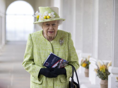 Queen Elizabeth arrives for the service to mark the centenary of the Royal Australian Air Force (Steve Reigate/Daily Express/PA)