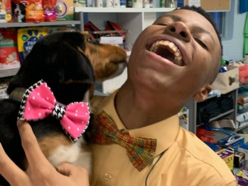 Darius Brown and a dog with a bow tie (Joy Brown)