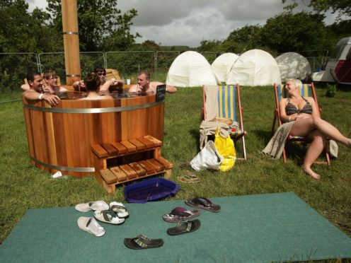 Festival-goers in a hot tub at the Isle of Wight Festival in 2013 (Yui Mok/PA)