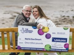 Neil and Sue Smart won £1m on the EuroMillions and plan to buy a bigger family home (National Lottery/PA)