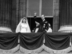 The newlyweds on the Palace balcony (PA)