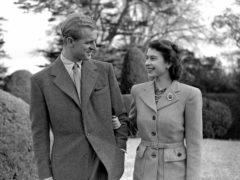 Princess Elizabeth enjoying a stroll with the Duke of Edinburgh on their honeymoon (PA)