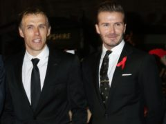 Phil Neville, left, tasted defeat in his first game working for David Beckham in Miami (Yui Mok/PA)