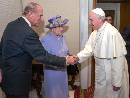 The Duke of Edinburgh shakes hands with Pope Francis as the Queen looks on (Arthur Edwards/The Sun/PA)