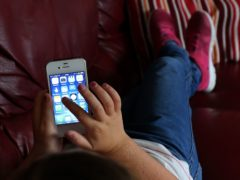 While parents are worried about children's online spending, only 18% have spoken to them about it in the last six months, according to a survey (Peter Byrne/PA)