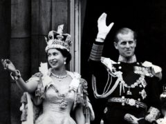 Queen Elizabeth and the Duke of Edinburgh waving from Buckingham Palace on Coronation Day (PA)