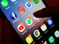 A third of UK adults intend to use social media and personal messaging apps to encourage people to get vaccinated (Yui Mok/PA)