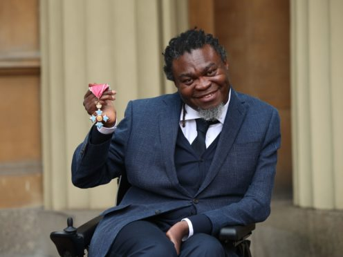 Yinka Shonibare holds his CBE for services to art (Yui Mok/PA)