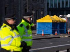 Police tents outside Fishmonger's Hall, on London Bridge, following the attack (Dominic Lipinski/PA)