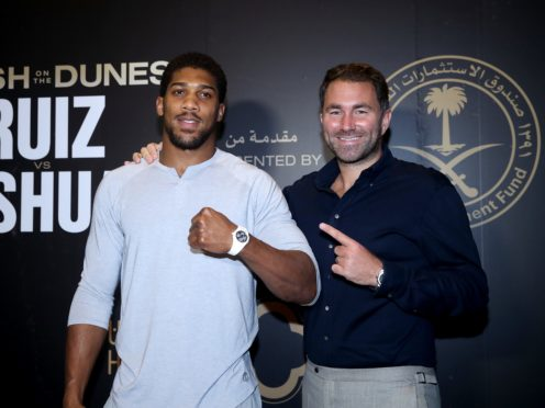 Eddie Hearn, left, is convinced a fight between Anthony Joshua, right, and Tyson Fury will go ahead this summer (Nick Potts/PA)