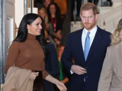 Prince Harry will return to the UK for his grandfather's funeral, but Meghan will remain in the US (Yui Mok/PA)