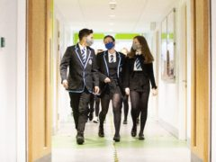 Students at St Columba's High School, Gourock, wear protective face masks as they head to lessons as the requirement for secondary school pupils to wear face coverings when moving around school comes into effect from today across Scotland.