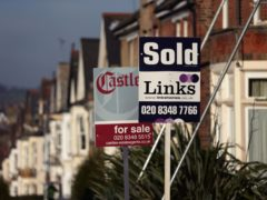 Estate agents' sold signs (Yui Mok/PA)