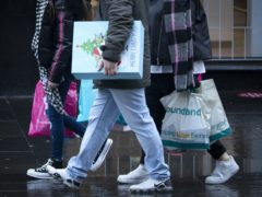 Shoppers have been asked to follow social distancing and other Covid safety measures (Jane Barlow/PA)
