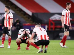 Sheffield United players react after a Premier League match against Everton (Alex Pantling/PA)