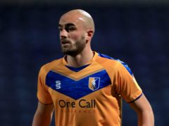 Mansfield will be without Farrend Rawson against Oldham (Mike Egerton/PA)