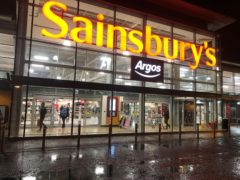 Sainsbury's has enjoyed a boost in sales but profits fell (Michael McHugh/PA)