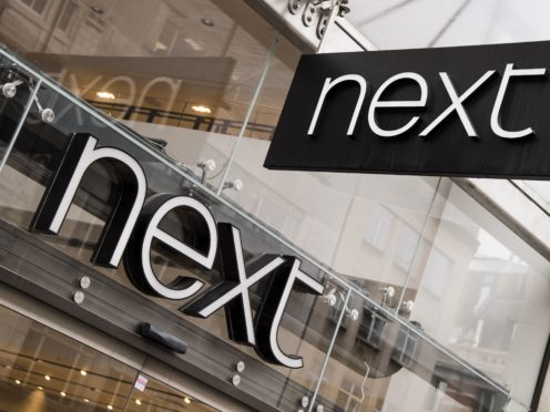 Next said its profits plunged by 54% due to lockdown restrictions (Ian West/PA)