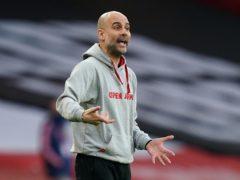 Pep Guardiola has said Manchester City may not sign a striker this summer (John Walton/PA)