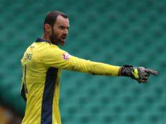 Aberdeen goalkeeper Joe Lewis missed the match against Celtic (Andrew Milligan/PA)