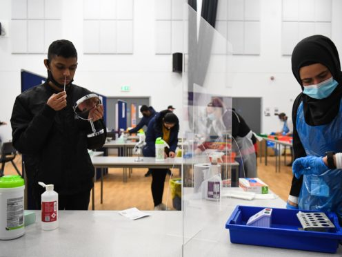 A student takes a lateral flow Covid-19 test at Hounslow Kingsley Academy in west London in March 2021 (Kirsty O'Connor/PA)