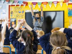 P3 teacher Jessica Cargill with her class at Springfield Primary School in Belfast (Liam McBurney/PA)